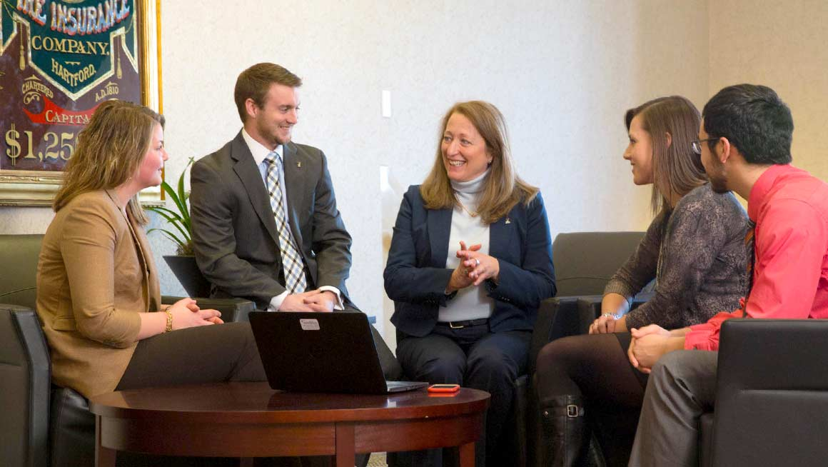 Marissa Crean '81 (center) enjoys advising students and alumni