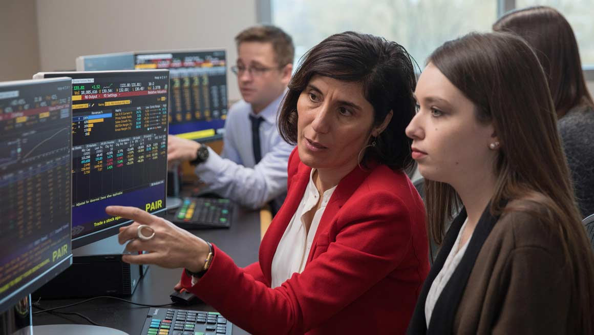 Bryant Finance Professor Asli Ascioglu at the Bloomberg Terminals