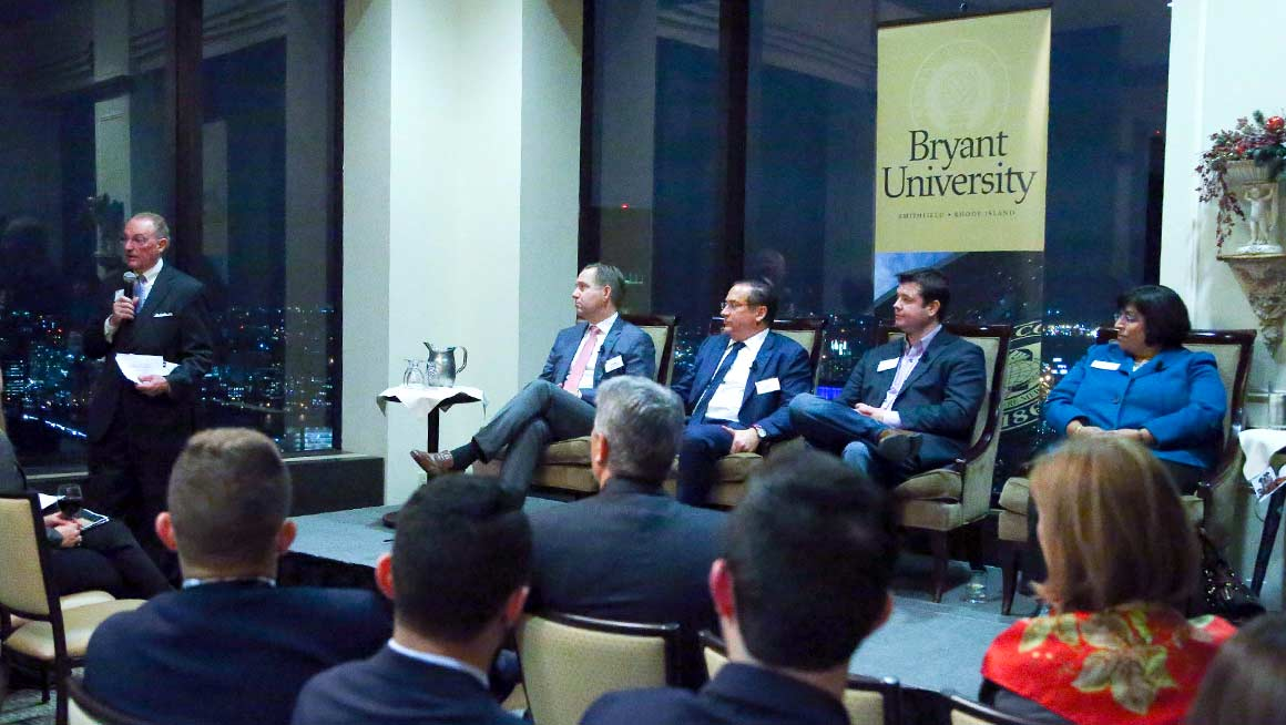 Bryant President Ronald K. Machtley addresses alumni and students at the Downtown Harvard Club in Boston