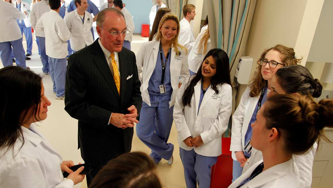 President Machtley with Bryant PA students at the opening of the Physician Assistant Learning Center