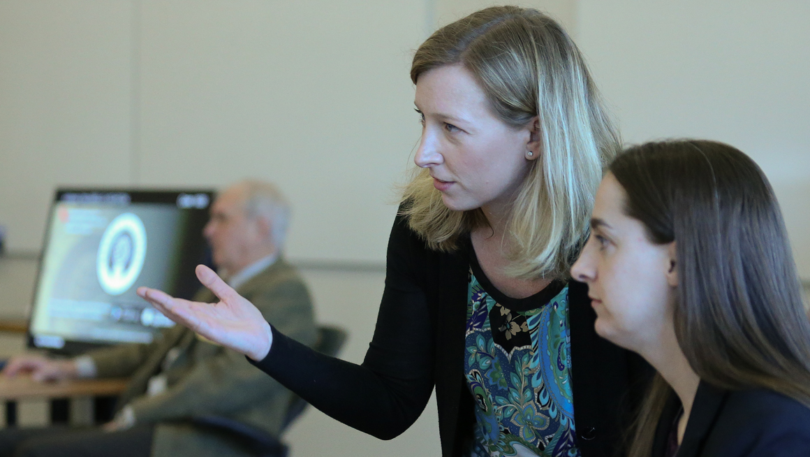 Allison Butler, Associate Professor of Applied Psychology, working with faculty members
