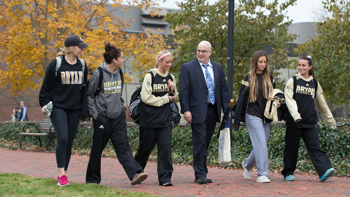 Rabbi Jablow walks with students on campus