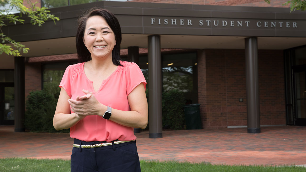 Mailee Kue stands in front of Fisher Student Center