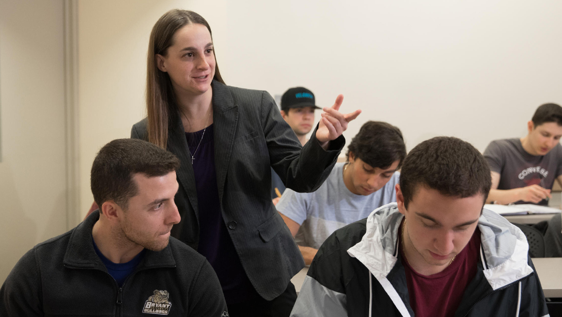 Economics Prof. Beaudin in classroom with students