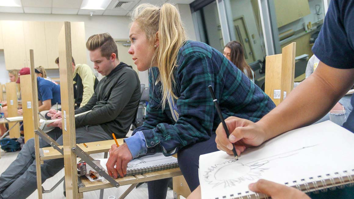 Student sketching in Bryant art studio