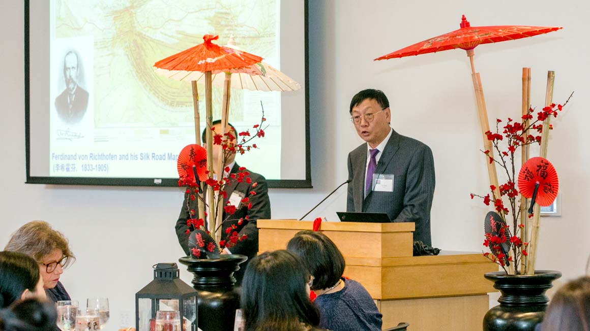 Prof. Lin Yang speaks to Bryant University guests