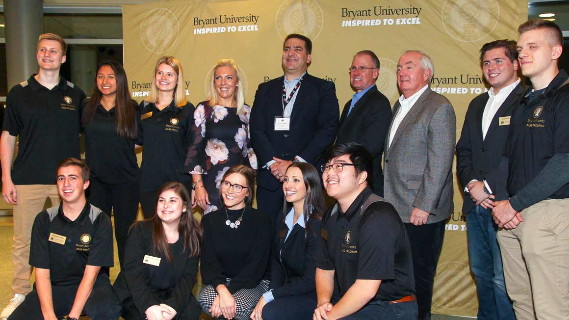 Students, faculty, and speakers at Bryant's inaugural Sales Symposium