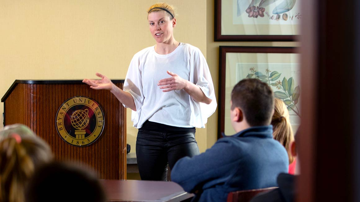 Monika Sattler '09 speaks to global studies and international business students.