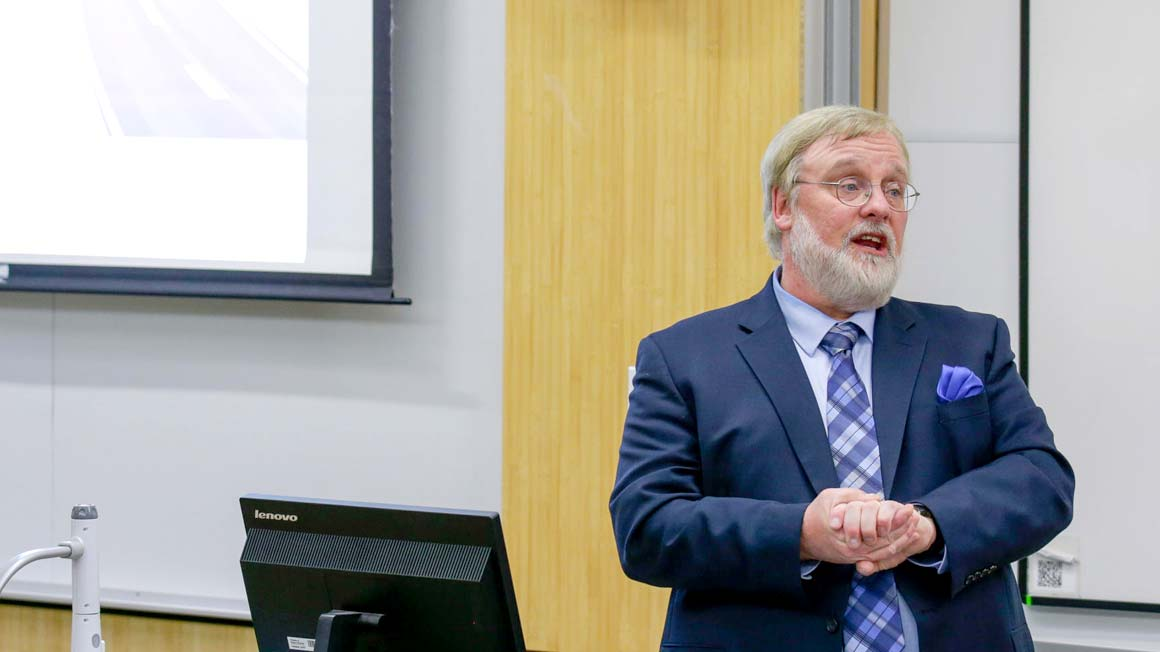 Professor Rich Gorvett speaks in classroom