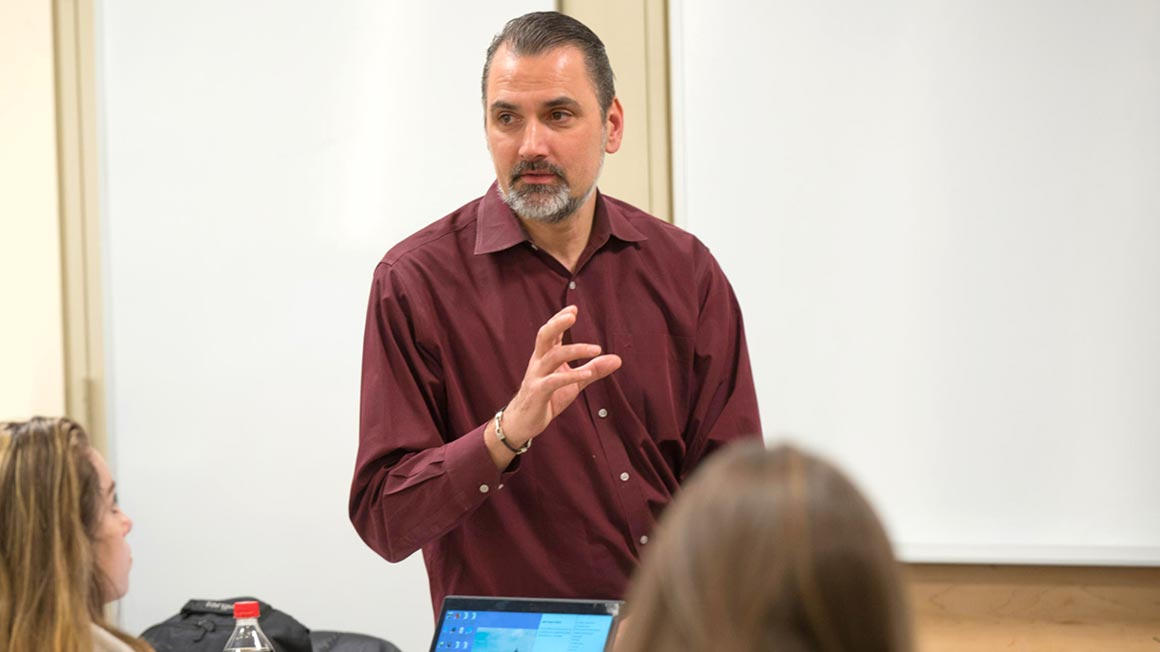 Associate Professor of Management Dirk Primus in the classroom