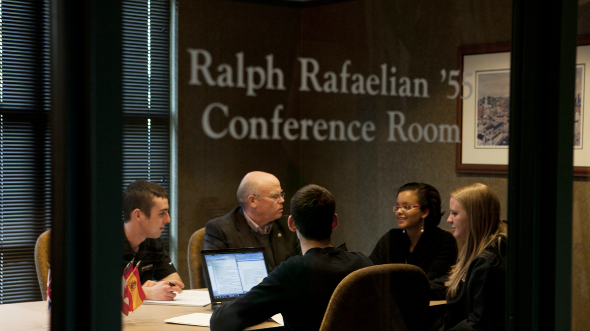 Ray Fogarty confers with students and faculty