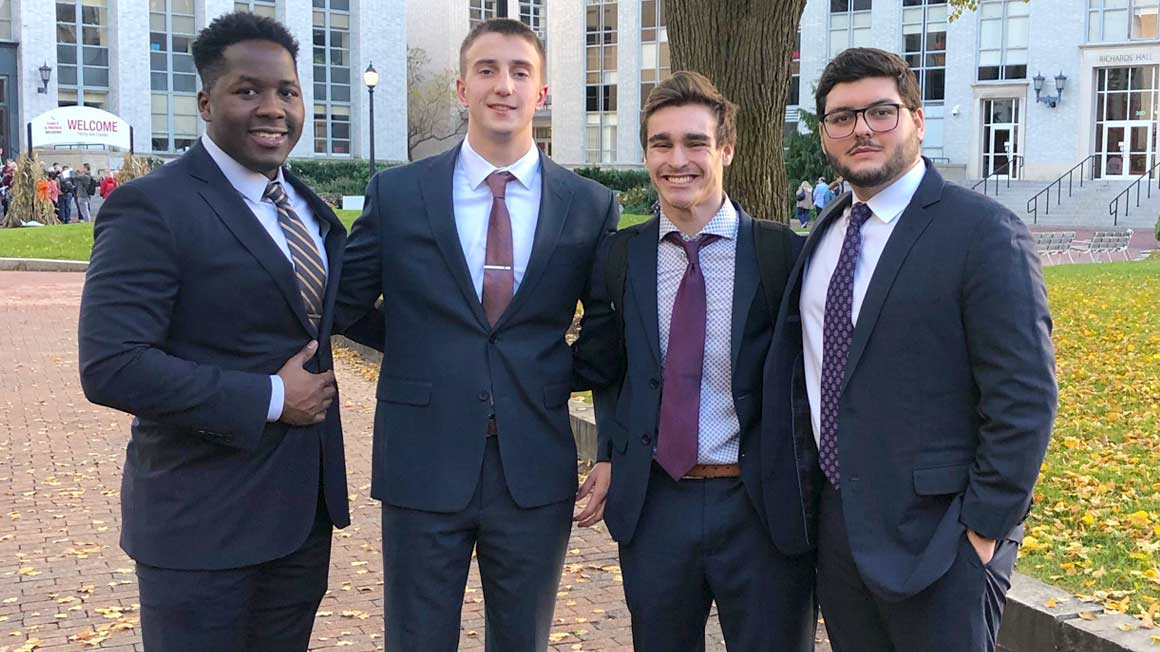 Four Bryant students who competed in an academic data science competition
