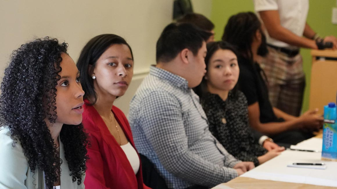 Alumni panelists address students