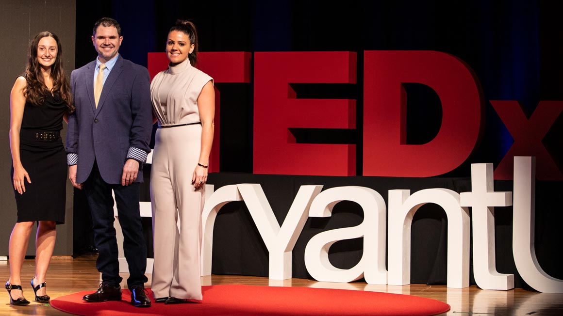 Bryant alumni on stage at TEDxBryantU in February 2020