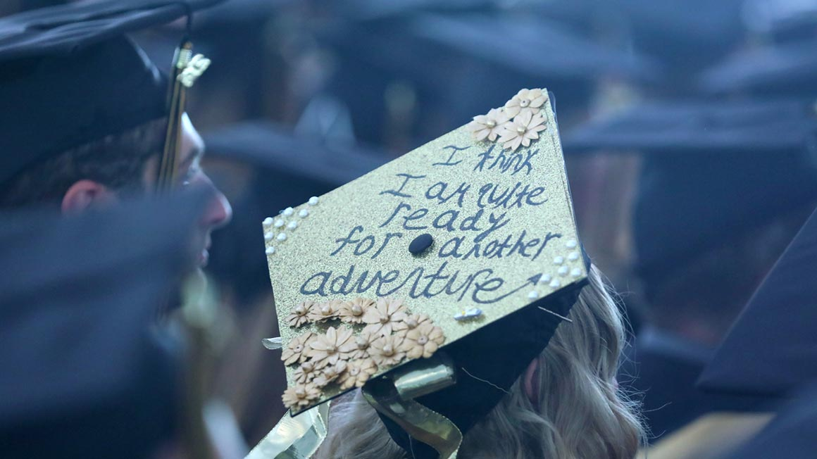 Photo of Bryant graduate wearing decorated graduation cap.