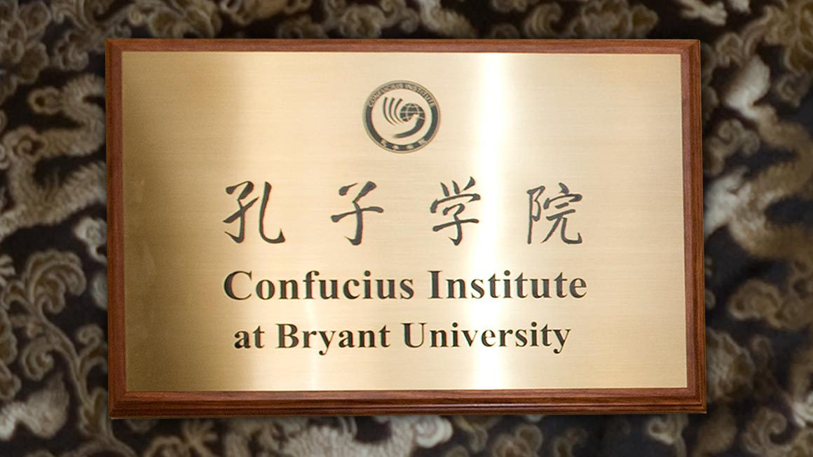 Brass nameplate reads Confucius Institute at Bryant University